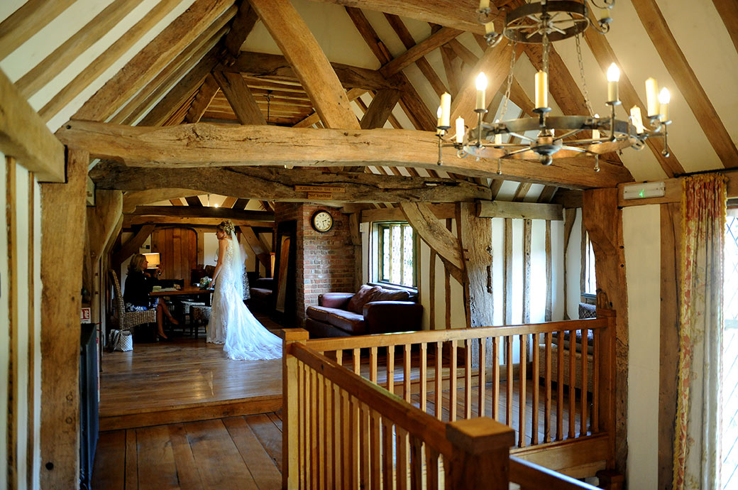 Wedding photograph of a Bride being interviewed by the marriage registrars at the popular and homely Surrey wedding venue Cain Manor on the stair landing