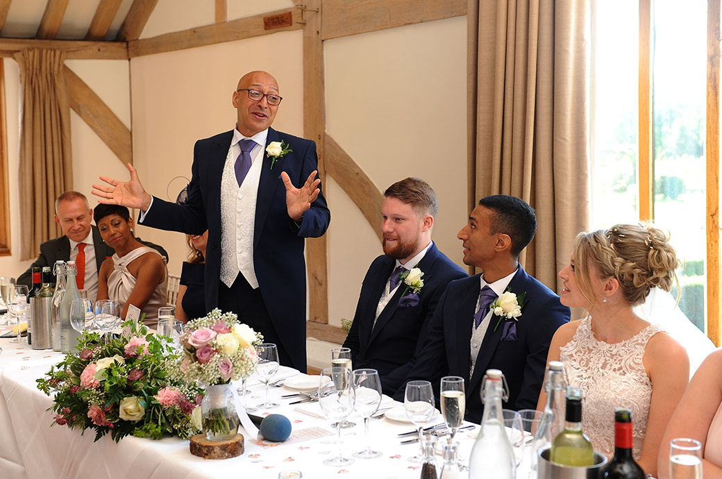 Groom's father delivers a touching message to his new Daughter in Law during his wedding speech captured in the Music Room at the Cain Manor wedding venue in Surrey