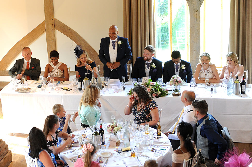 Father of the Groom captured in the Music Room at Surrey venue Cain Manor entertaining the guests during the wedding breakfast speeches