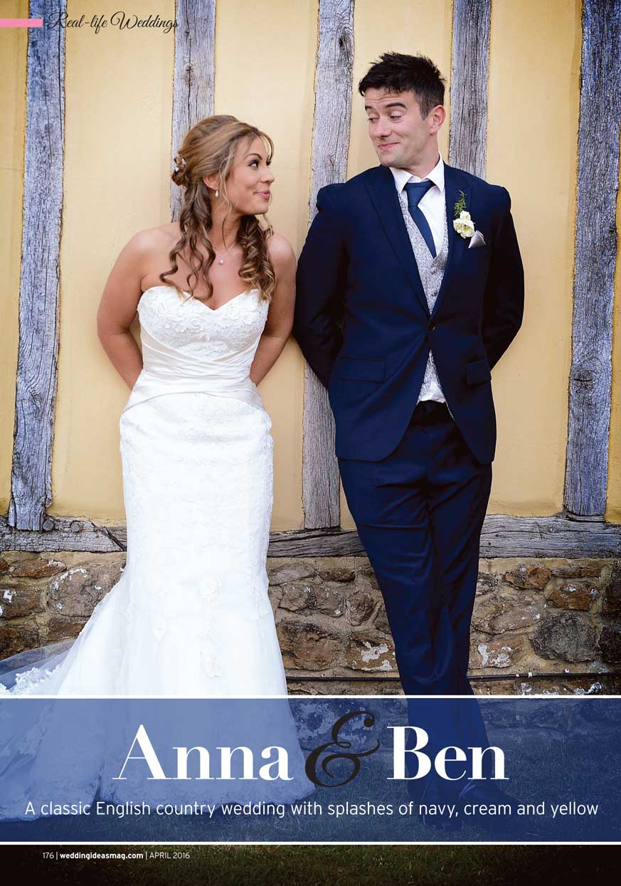Bride and Groom smiling as they lean on the old wall of the beautifully rustic Surrey wedding venue Cain Manor as featured in the April 2016 edition of Wedding Ideas Magazine