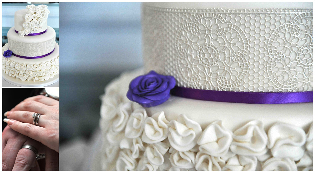 White three tiered wedding cake with a mauve ribbon captured at Surrey venue Gorse Hill along with a close up of the Bride and Grooms wedding rings as they cut it