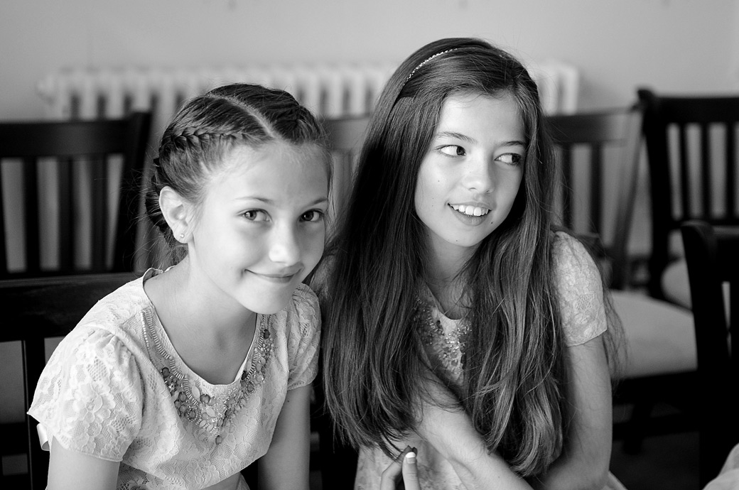 Smiling girls waiting for their parents to finish their interviews  at  Surrey wedding venue Guildford Register Office  in the smaller Artington House marriage room