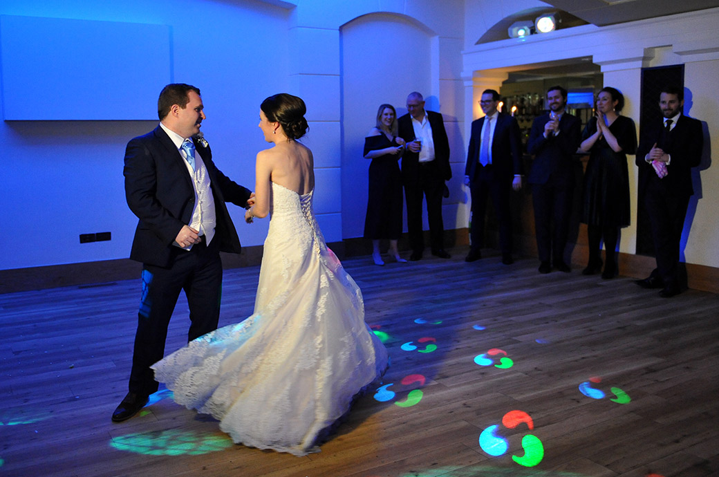 The action hots up on The Belvedere Suite dance floor as the newlyweds try out their first dance moves at Pembroke Lodge Surrey