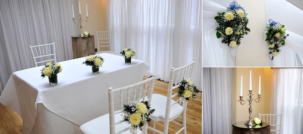 Yellow roses displayed on the Bride and Groom's chairs, the marriage table and on the walls in The Belvedere Suite at Surrey wedding venue Pembroke Lodge Richmond