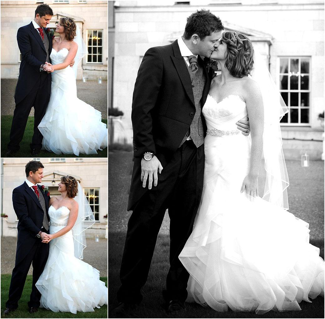 Romantic wedding photographs at the front of the stately Surrey wedding venue Addington Palace of a handsome Bride and groom holding hands exchanging looks and kissing