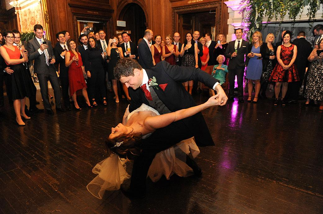 The Groom's masterful dance moves in full view as he and his bride perform their first dance at Addington Palace in Croydon Surrey in the atmospheric Great Hall