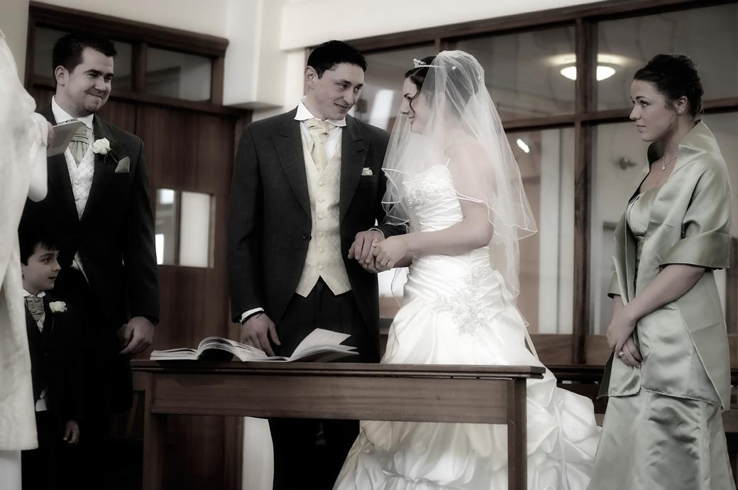 Bride and Groom stare lovingly into each others eyes in this romantic wedding picture taken at the Surrey wedding venue Addiscombe Catholic Church