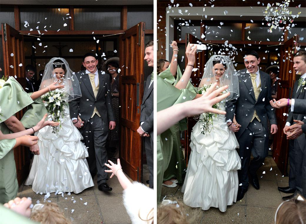 Smiling Bride and Groom in these two fun confetti wedding photos taken at Addiscombe Catholic Church Our Lady of the Annunciation a Surrey wedding venue near Croydon