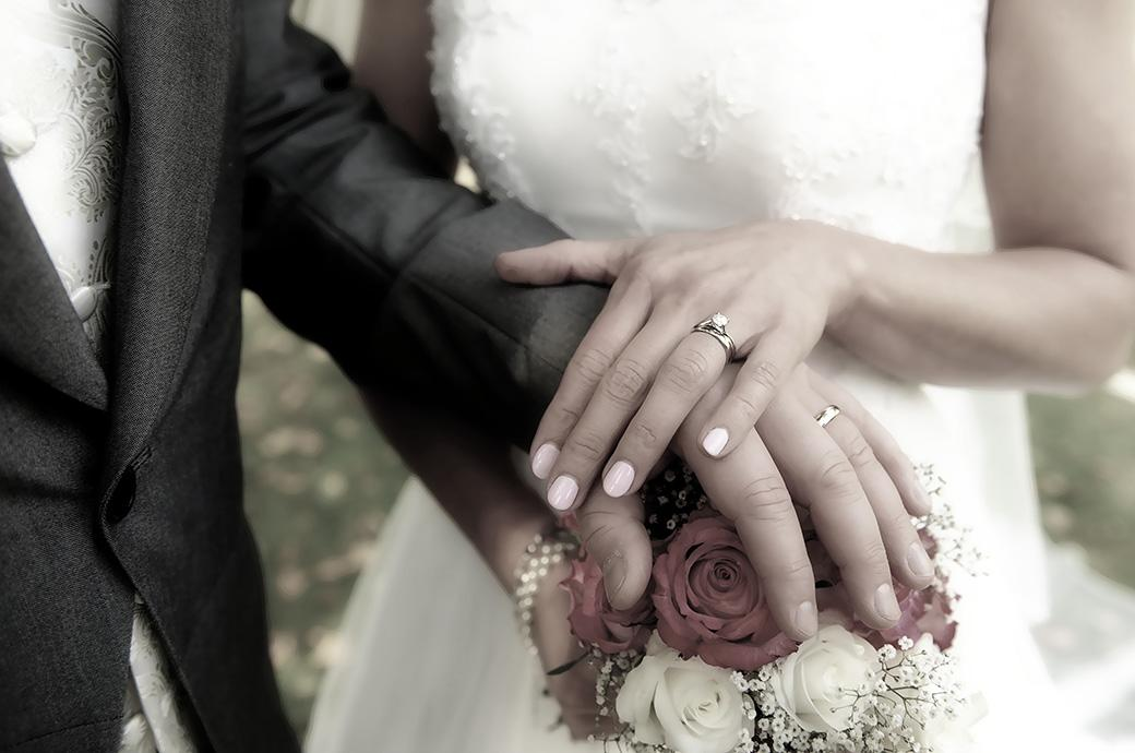 The Bride and groom captured at Surrey venue Burford Bridge Hotel near Boxhill Dorking showing off their wedding rings