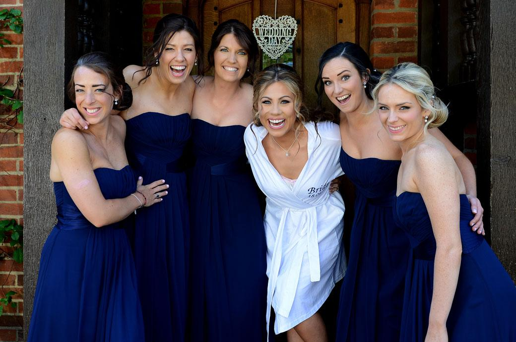 All fun and smiles for the beautiful Bride and her lovely Bridesmaids captured in this wedding photo taken at the Bride's parent's home near the wedding venue Cain Manor in Surrey
