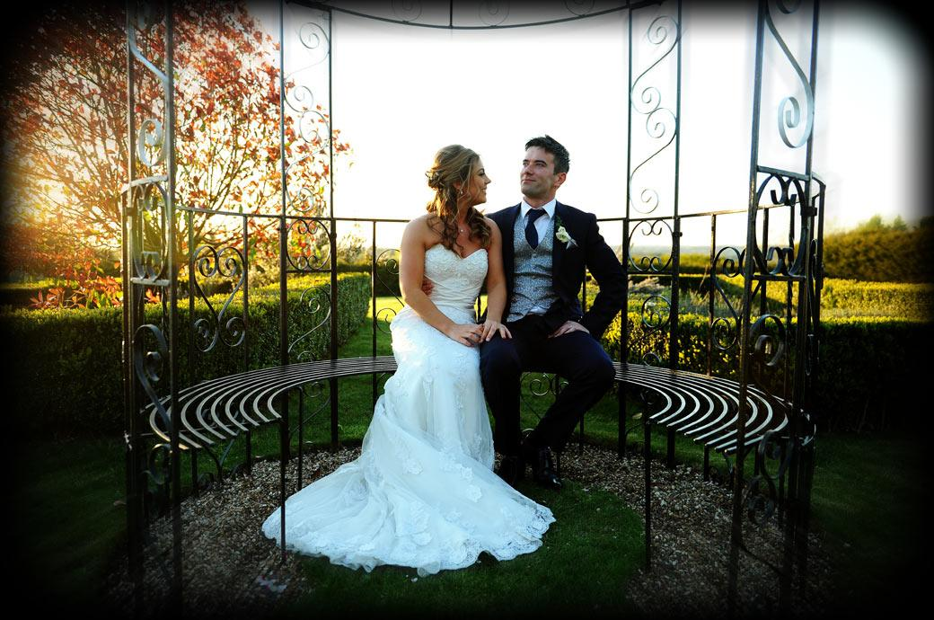The newlywed couple take time out for some romantic moments together in the tranquil and relaxing grounds of Cain Manor captured in this Surrey wedding picture