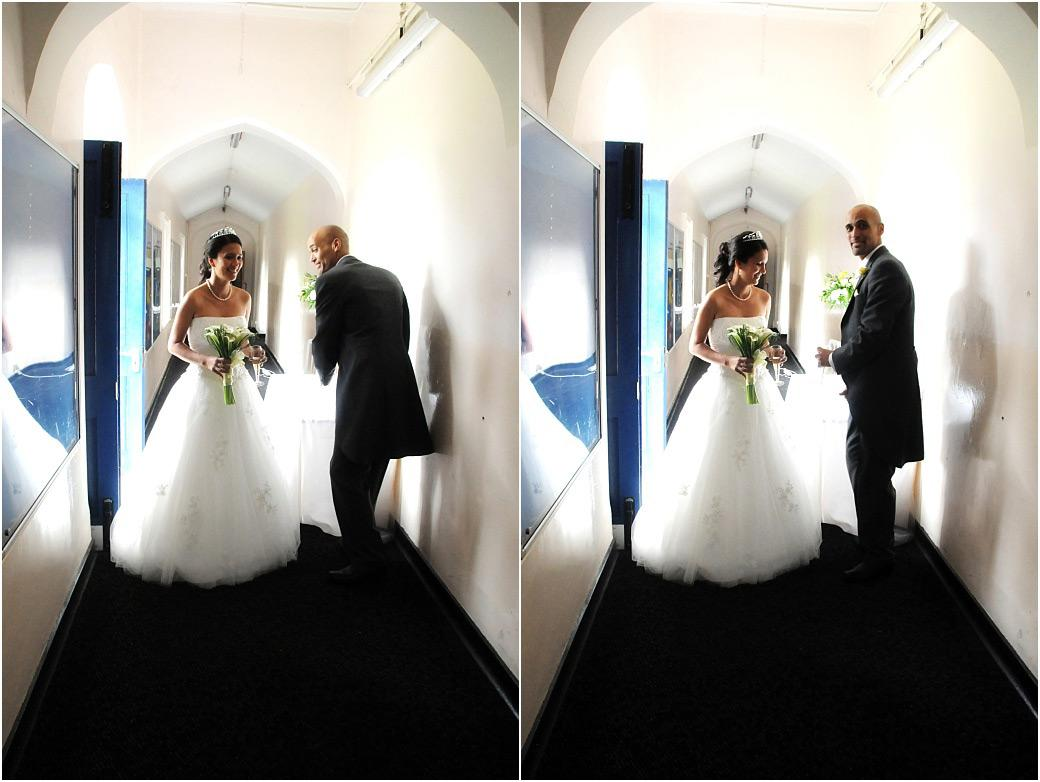 Newlywed couple at Surrey wedding venue Carew Manor in Beddington getting themselves ready in the corridor before entering the reception in The Great Hall