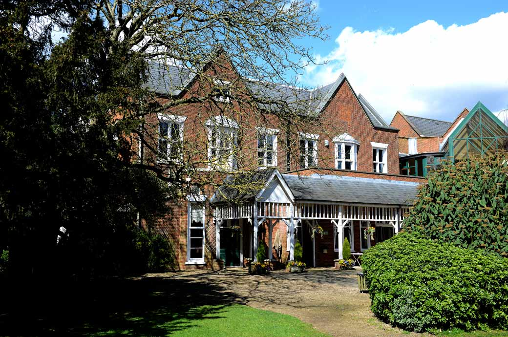 Picture of the 19th Century county house now know as Coulsdon Manor captured by a Surrey Lane wedding photographer from the garden area