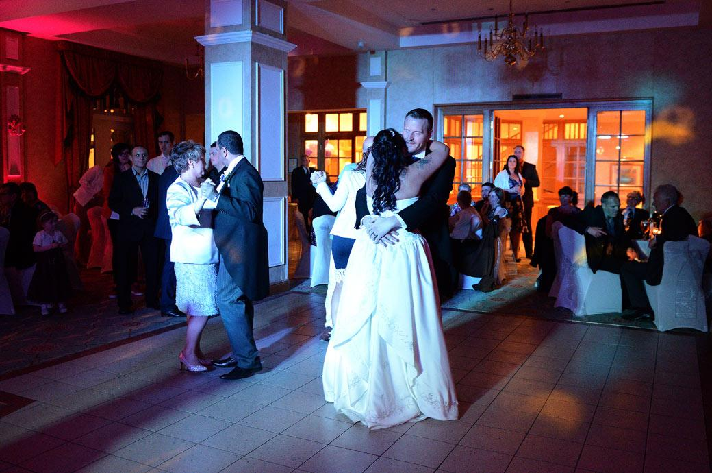 The Bride and groom are joined on the dancefloor as the evening celebrations begin to hot up at Surrey wedding venue Coulsdon Manor in The Manor House Suite
