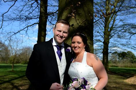 Wedding picture of the happily married newlywed couple taking time out for a romantic walk in the grounds of Surrey wedding venue Coulsdon Manor