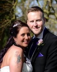 Coulsdon Manor Bride and Groom looking happy and relaxed in this portrait wedding photo taken in the grounds of the Surrey wedding venue Coulsdon Manor under the trees