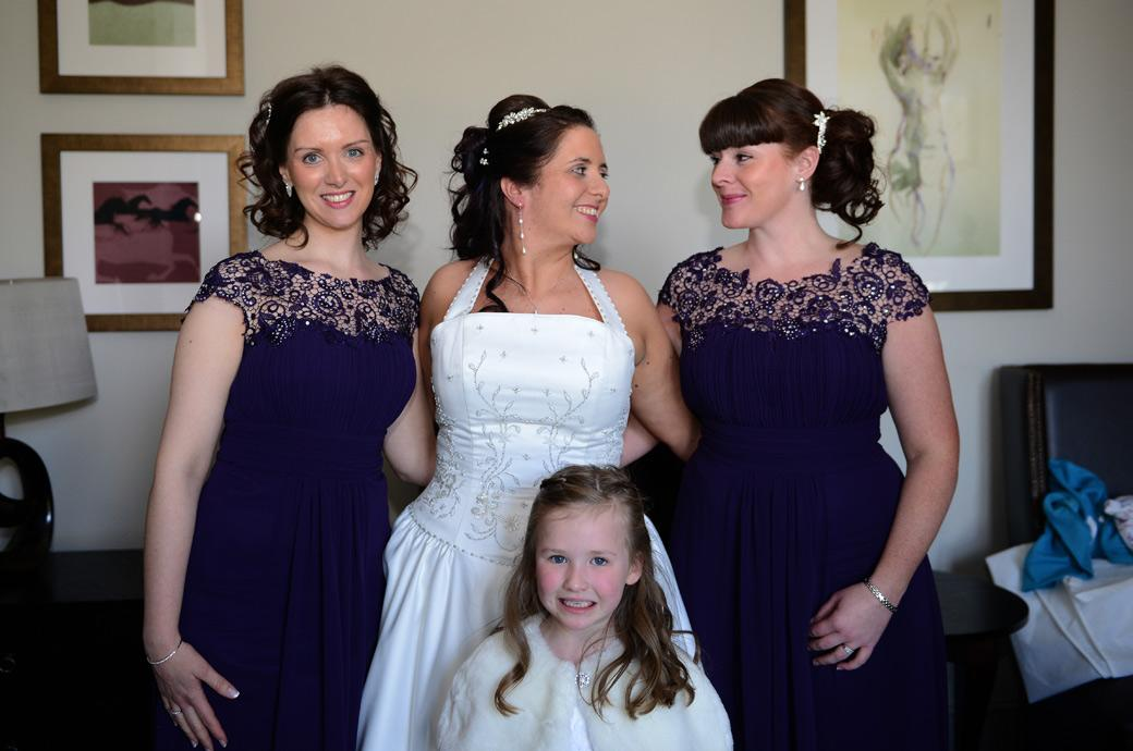 A very relaxed and happy Bride sharing a moment with her Bridesmaids at Coulsdon Manor Surrey in this wedding photo taken in the Highgrove suite