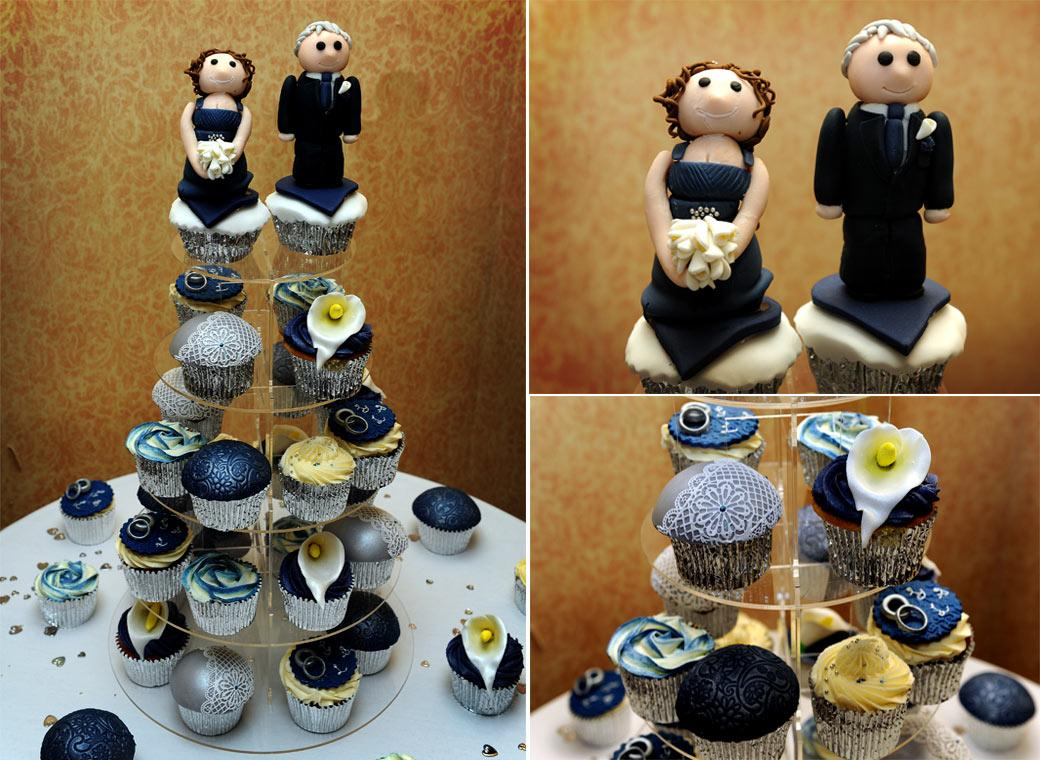 Lovely blue themed wedding cup cake display with fun Bride and Groom cake toppers captured at Coulsdon Manor Surrey in The Blenheim Suite