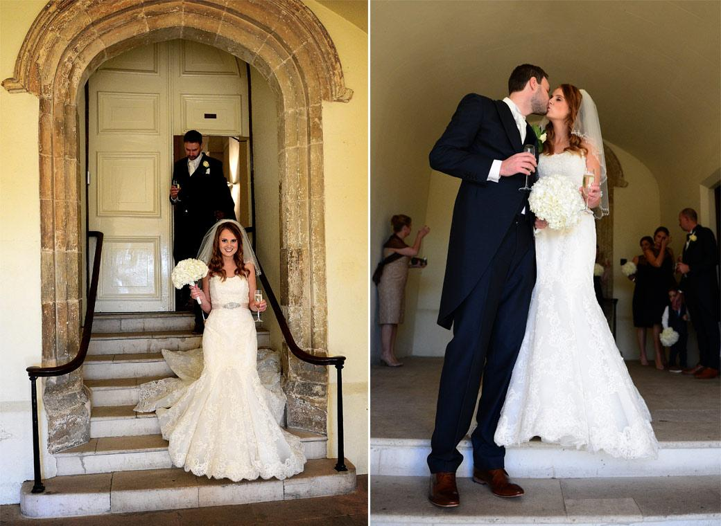 Leaving the main door from The Stone Hall with champagne in hand and kissing in these delightful wedding photos taken after a Surrey wedding at the fabulous Farnham Castle