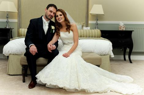 Bride and Groom in this wedding photograph taken as they sit in their wedding suite in Farnham Castle a stunning Surrey wedding venue