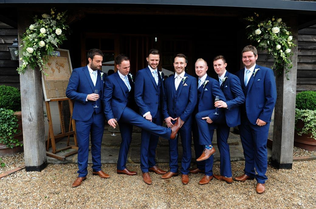 Smart Groom and Groomsmen in their blue suits and distinctive brown brogues at Gate Street Barn captured by a Surrey Lane wedding photographer