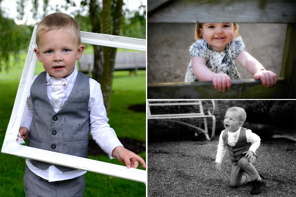 Chocolate stained children playing with frames and gates in theses sweet wedding photos taken in the lovely rustic grounds of Gate Street Barn in Bramley Surrey