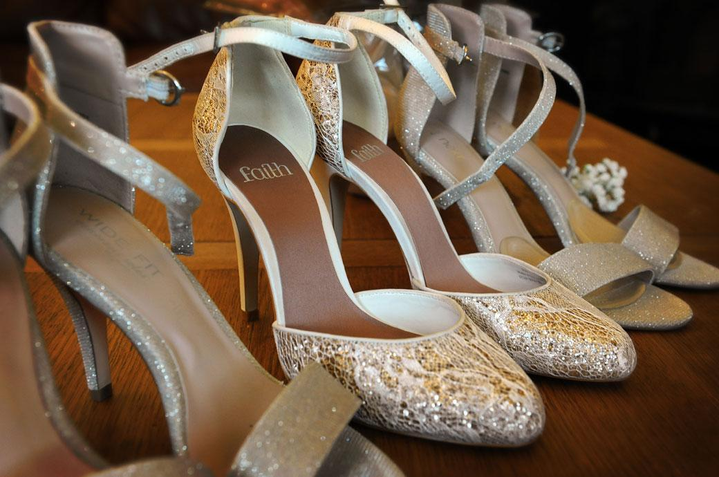 A row of sparkling ladies shoes waiting to be put on in this wedding picture taken at the charming and beautiful Gate Street Barn a wonderful Surrey wedding venue in the countryside