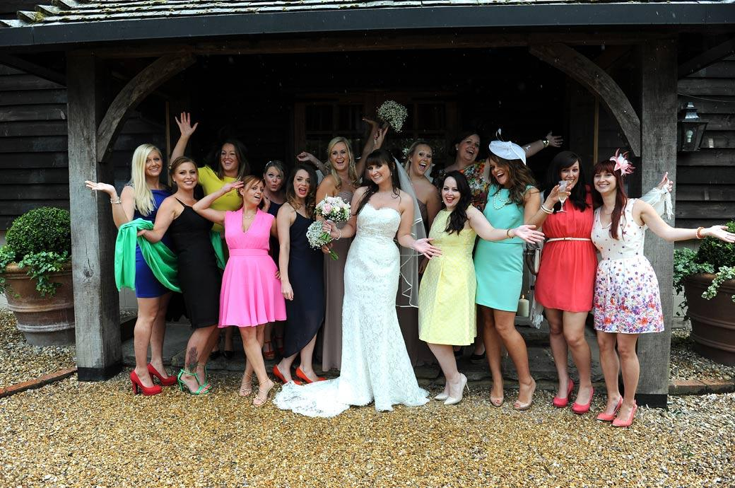 All smiles and waves from the Bride and her Hen night ladies in this fun wedding photo taken at the lovely Gate Street Barn by one of the Surrey Lane wedding photographers