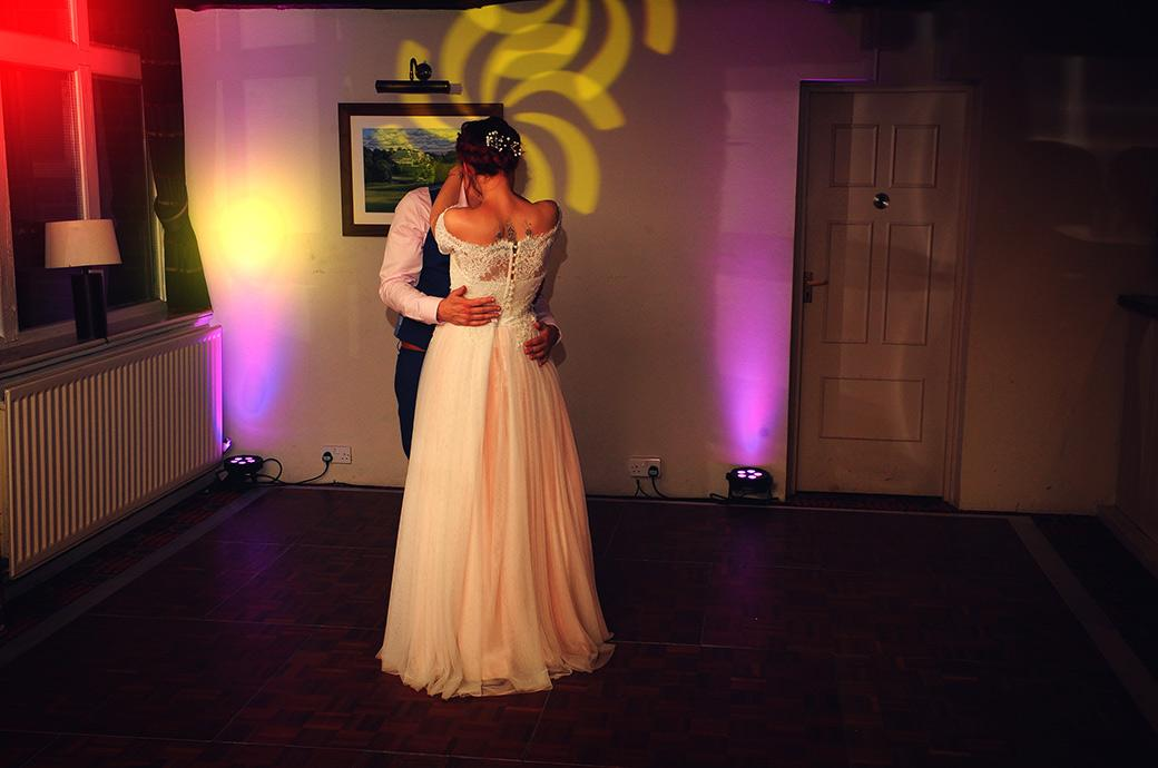 Romantic intimate moment captured at Surrey wedding venue Gatton Manor in Dorking as the newlyweds have their first dance