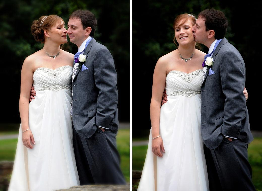 Two tender kiss moment wedding photographs of the young newly-wed couple taken in the scenic tranquil gardens at Gatton Manor Nr Dorking Surrey