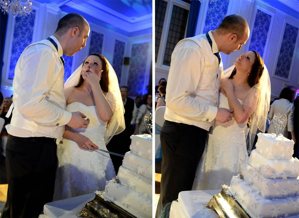 Romantic wedding photographs of the Bride and Groom trying their wedding cake at the reception in Glenmore House Surbiton Surrey
