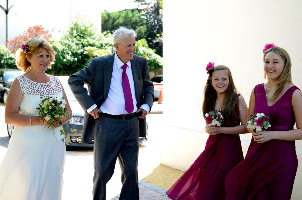 Laughing Bridesmaids as Father of the Bride cracks a joke in this delightful wedding photo taken at Glenmore House by Surrey Lane wedding photography