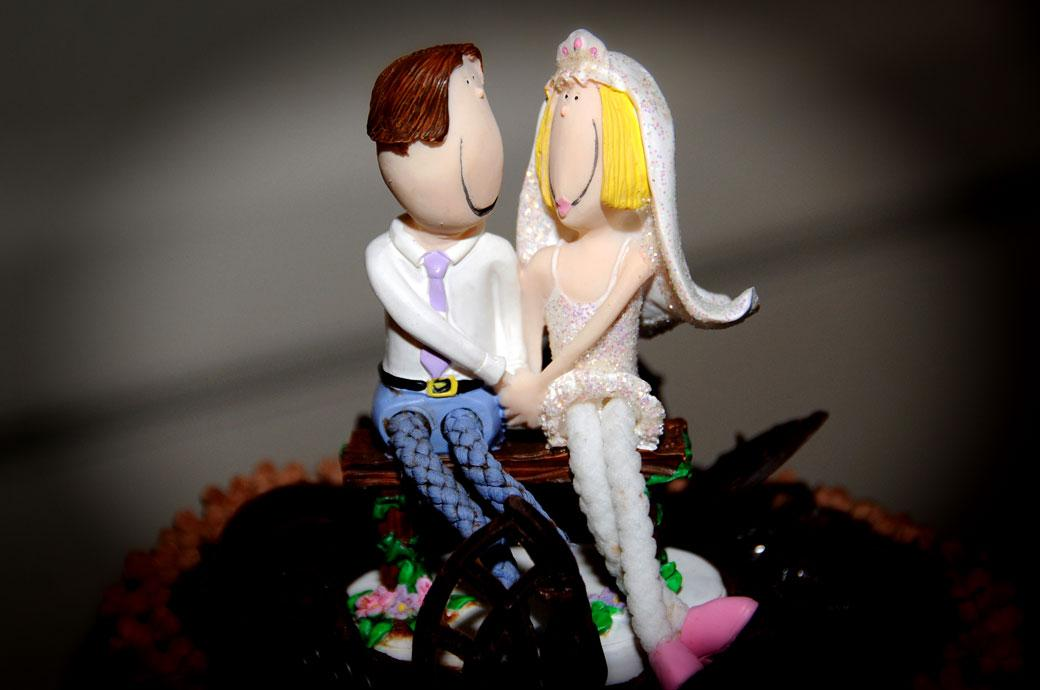 Fun loved up wacky cake topping figurines wedding picture taken at a Glenmore House wedding in the Surbiton Surrey wedding venue