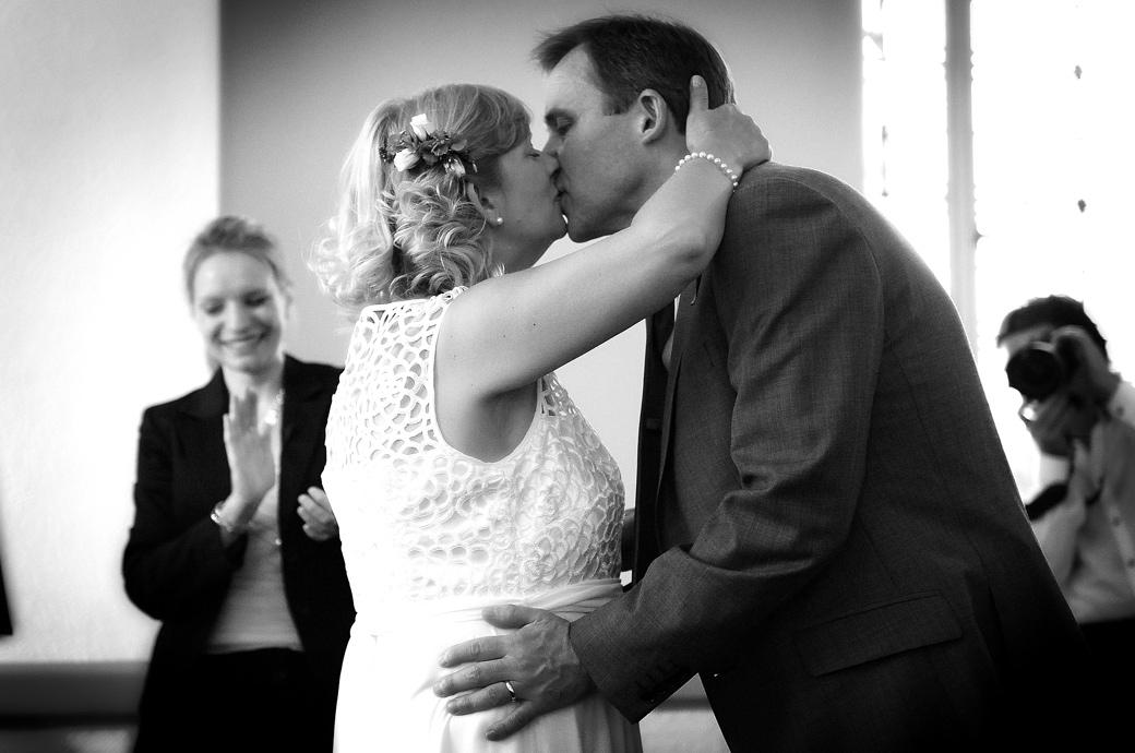 Husband and wife kiss in this romantic wedding picture captured by Surrey Lane wedding photography at Glenmore House in the Surbiton Conservation area