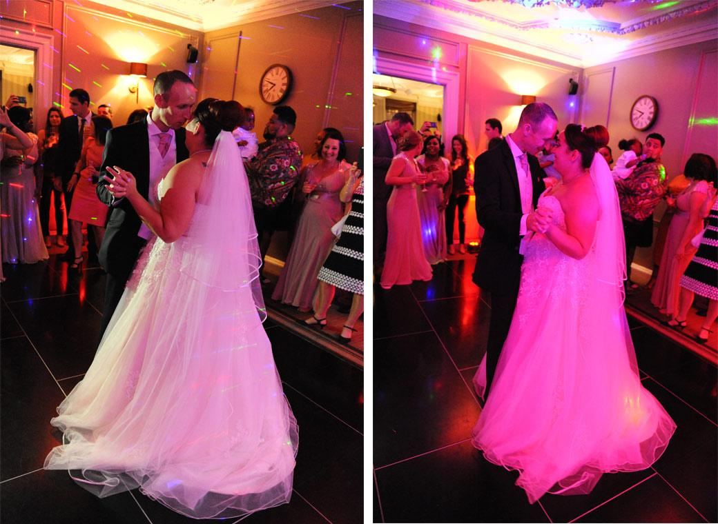 Bride and groom captured on this dance floor for their first dance in these colourful wedding photos taken at Gorse Hill Surrey in The Boardroom