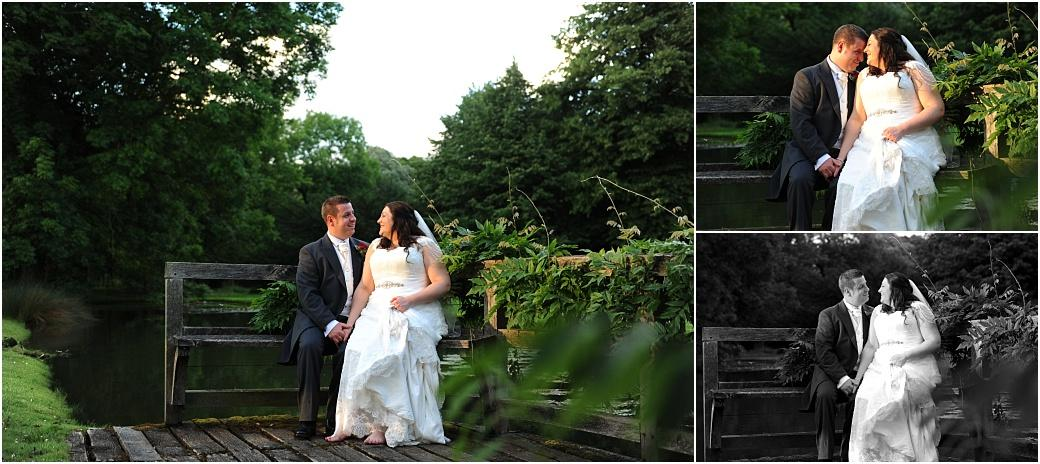 Romantic moments captured in these wedding pictures taken at Great Fosters in Egham Surrey as a newlywed couple sit on a bench by the Saxon Moat where the old bridge used to be