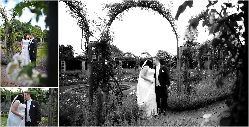 Romantic wedding pictures of the Bride and Groom walking and kissing at the stunning Surrey wedding venue Great Fosters in the beautiful and fragrant sunken rose garden