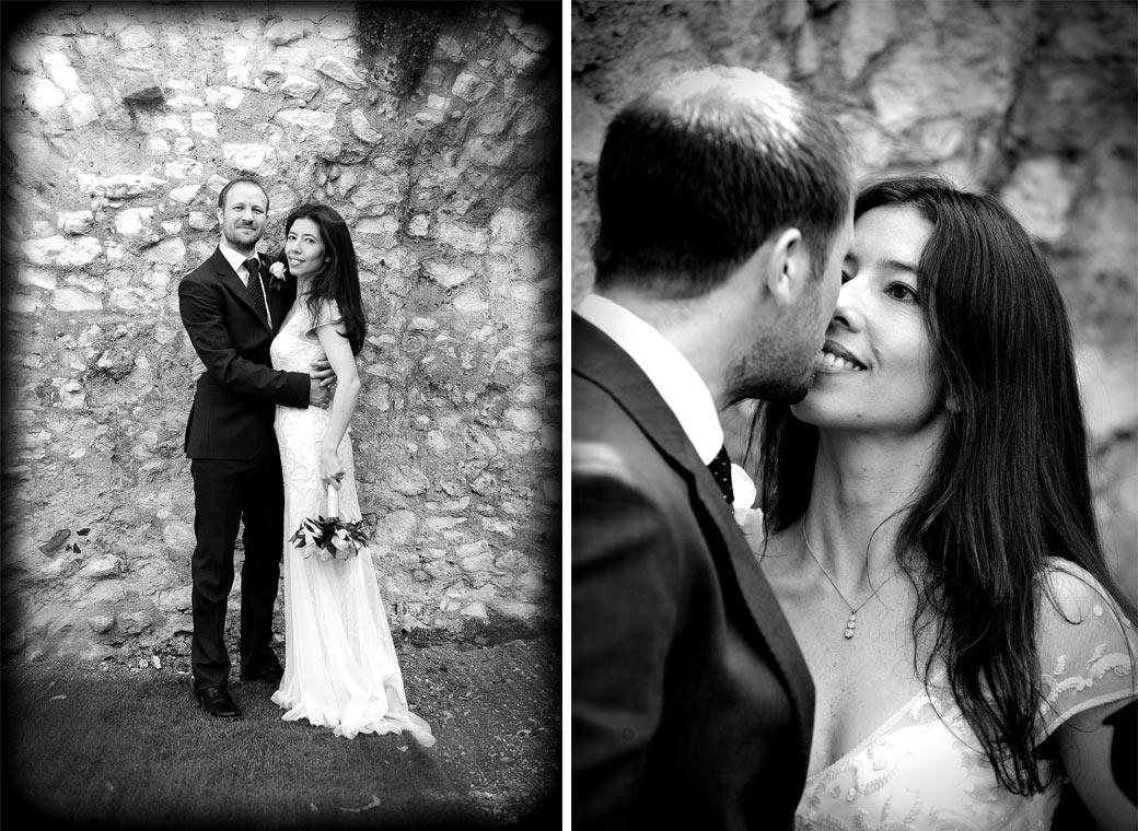 All smiles for the newlywed couple in these wedding photos taken by the solid ancient walls of Guildford Castle Surrey in the pleasant and popular gardens