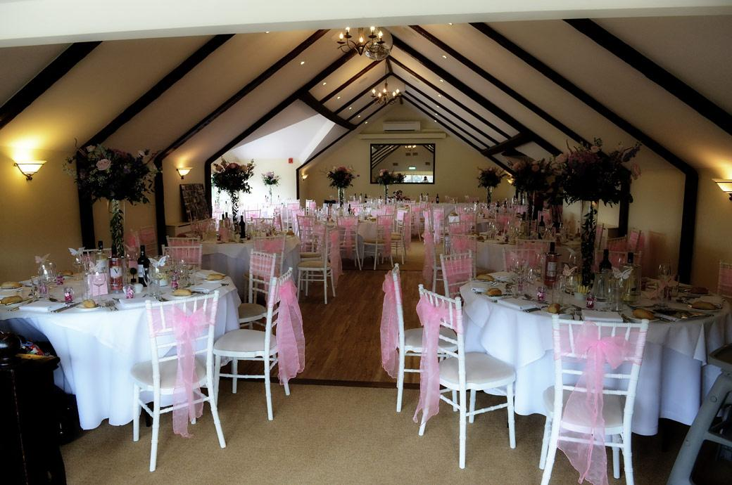 The Princes Suite dressed in pink and set up ready for the wedding breakfast in this picture taken by Surrey Lane wedding photography at Hever Castle Golf Club