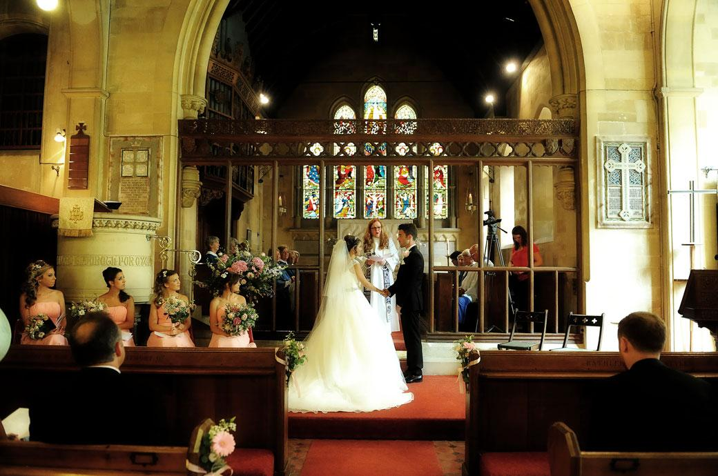 Wedding picture of a Bride and Groom standing to say their marriage vows at St Paul's Church Four Elms  before the reception at Hever Castle Golf Club an historic Kent wedding venue