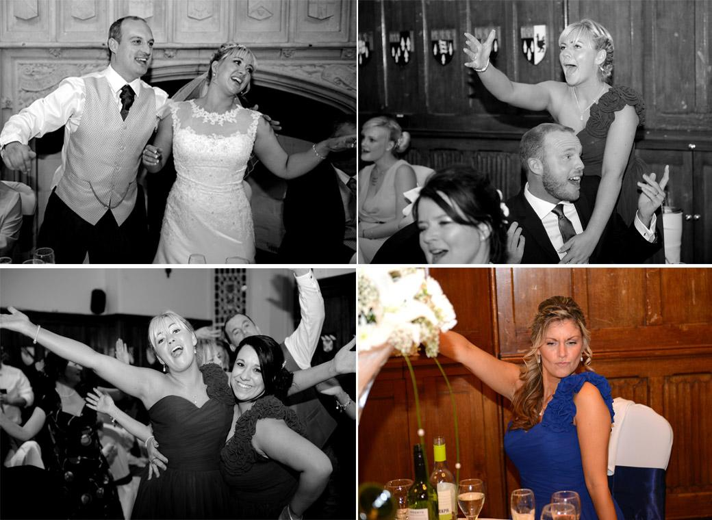 Bride, Groom and Bridesmaids all having fun joining in with the singing waiters musical show captured by Surrey Lane wedding photographers at Horsley Towers in the Great Hall