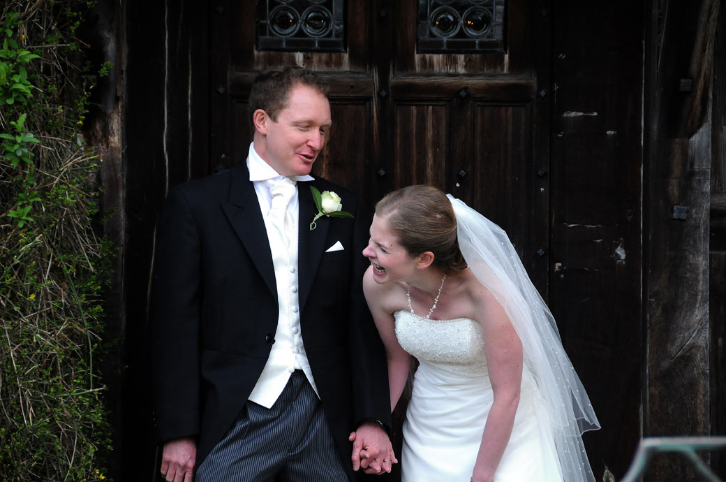 A lovely happy laughing Bride and Groom wedding picture taken at Langshot Manor by Surrey lane wedding photography