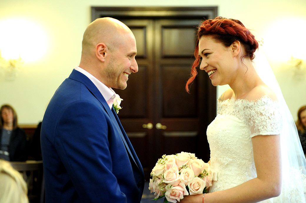 A high level of excitement capture in this lovely wedding photo taken at Surrey wedding venue Leatherhead Registry Office as the Bride and Groom turn to face each other