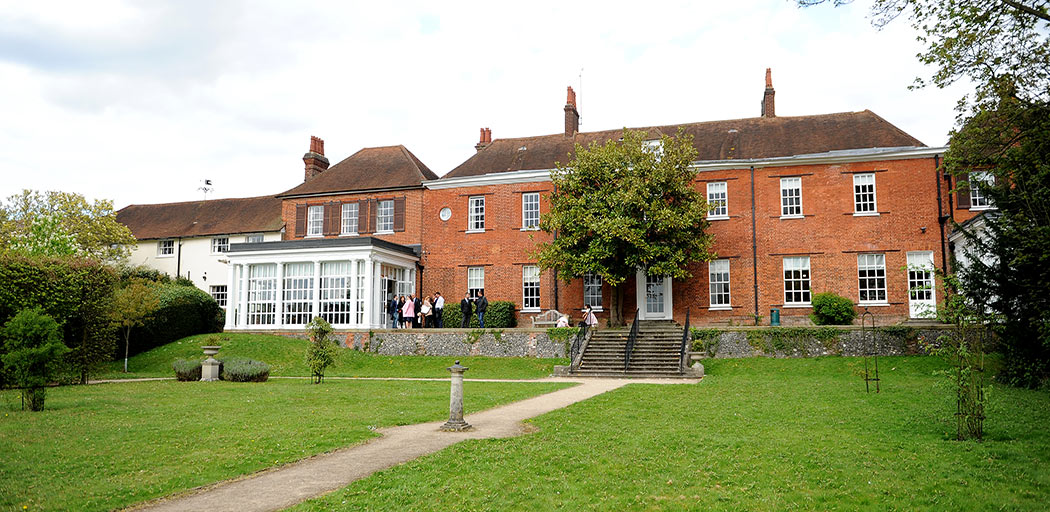 The elegant red bricked and historic Mansion House is home to Leatherhead Register Office a fine Surrey wedding venue with a large terrace and lawn area at the back