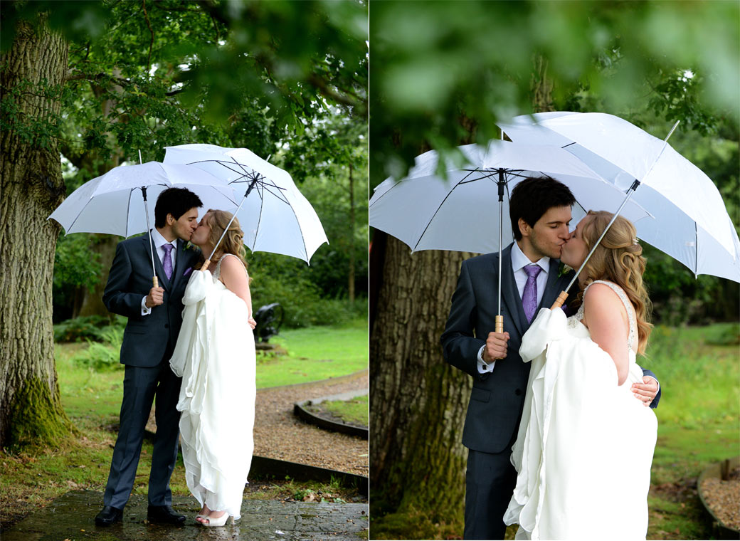 Two romantic wedding photographs of the Bride and groom kissing in the green and tranquil lawn area at the delightful Lythe Hill Hotel in leafy Surrey
