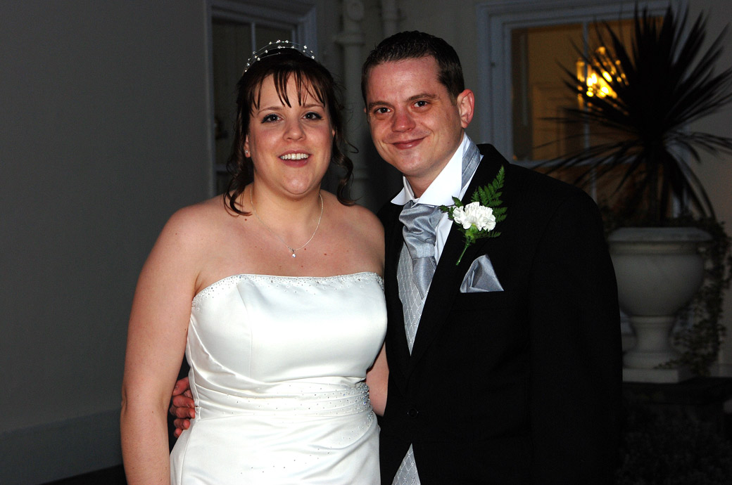 Wedding picture of a happy Bride and groom smiling after getting married at the ever popular Surrey wedding venue Merton Register Office in Morden Park House