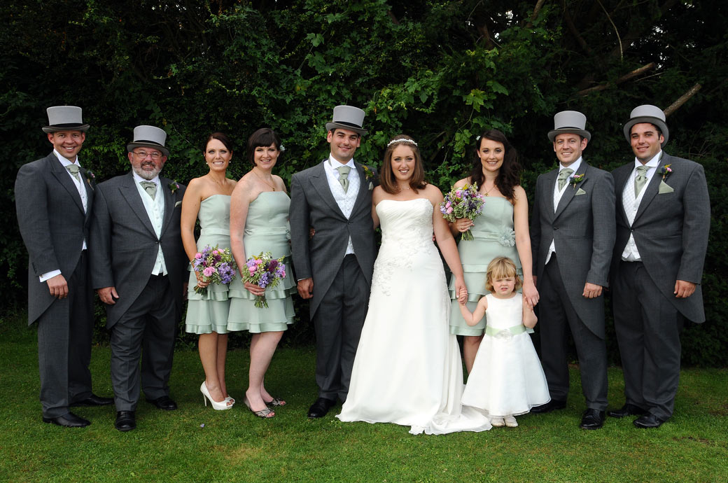 A lovely classic group wedding photograph of the smart and relaxed wedding party captured at Nonsuch Mansion by Surrey Lane wedding photography