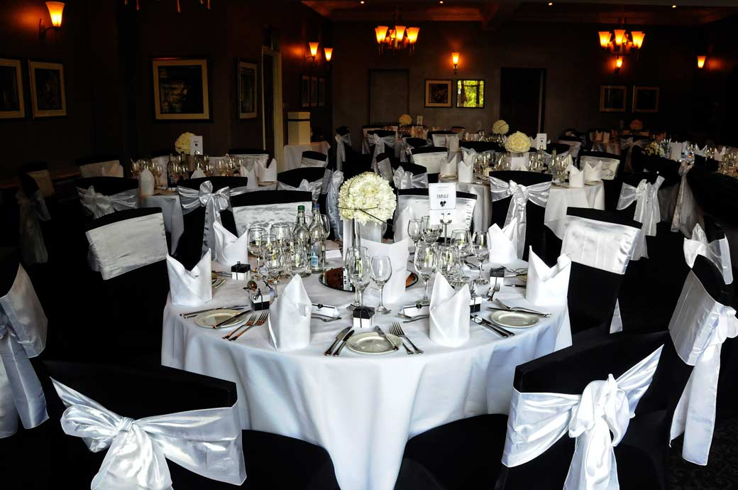 The attractive black and white themed Fielden Suite table settings wedding picture taken at the impressive Surrey wedding venue Nutfield Priory