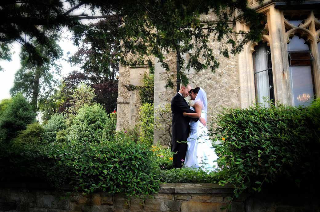 Romantic nose touching personal moment wedding photograph captured at on the terrace in Nutfield Priory, Redhill by Surrey Lane wedding photographers