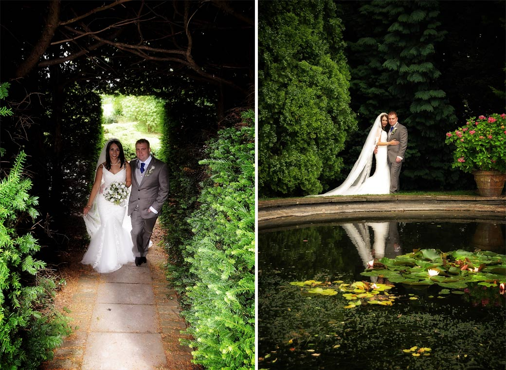 Newly-weds walking under the trees and reflections in the pond at the pretty Surrey wedding venue Oaks Farm near Croydon in Shirley